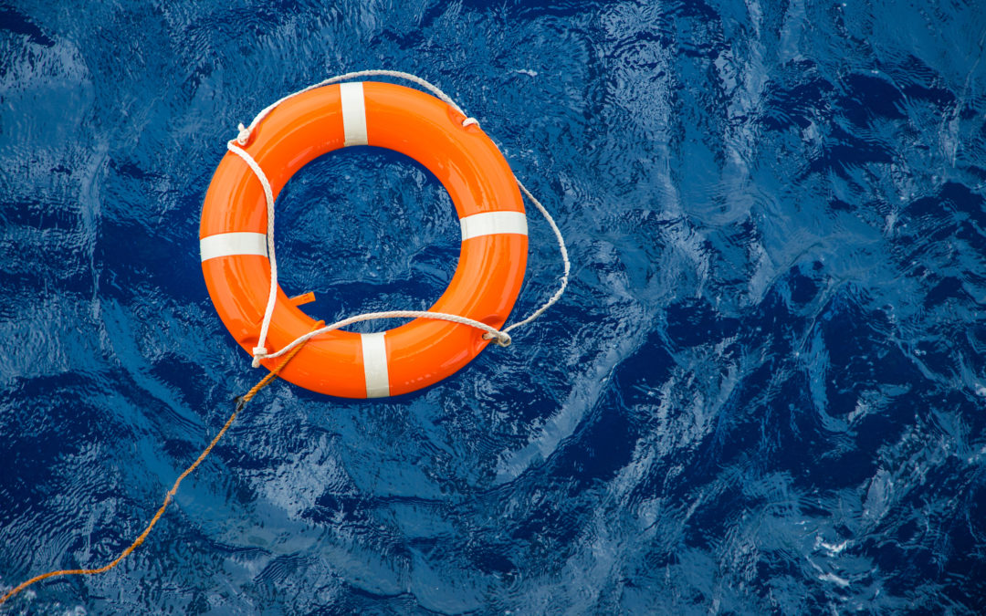 Safety equipment, Life buoy or rescue buoy floating on sea to rescue people from drowning man like the role of an interventionist